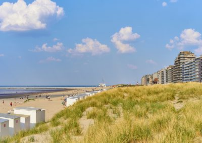 Roofed beach chairs at beach of Nieuwpoort in Belgium